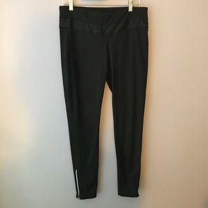 Black athletic leggings with zipper detail